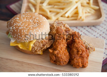 Burger, french fries and fried chicken.