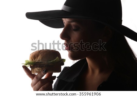 burger hamburger American junk fast food beautiful brunette girl with red lipstick on beautiful lips and beef burger with grilled bacon  hungry facial expressions