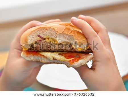 Burger in hands - stock photo