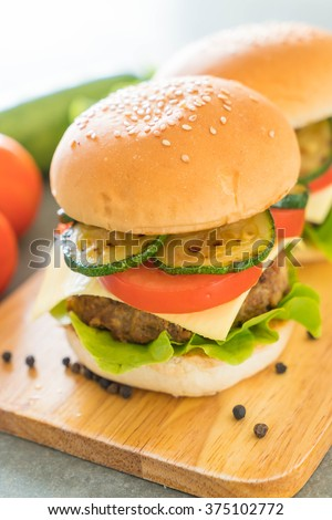 burger on wood plate  - American food