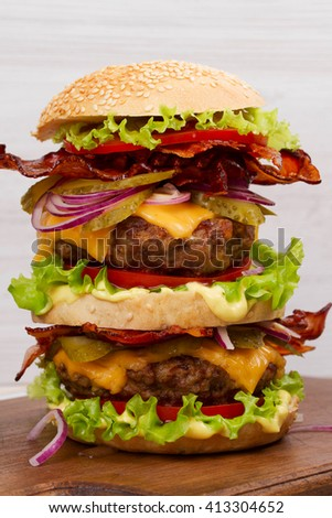 Burger With Beef, Bacon, Tomato, Cheese, Lettuce and Onion - stock photo