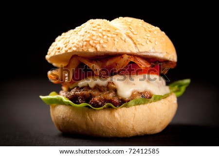burger with cheese,lettuce and tomato - stock photo