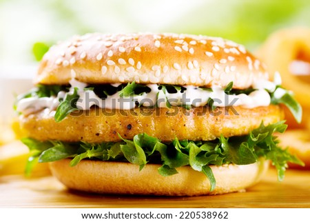 burger with chicken on wooden table - stock photo