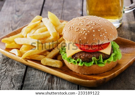 burger with French fries cutlet with cheese and tomato