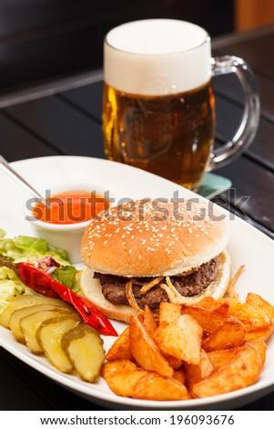 burger with mug of beer - stock photo