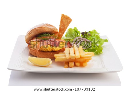 burger with smoked salmon and scrambled egg served with french fried isolated on white. - stock photo