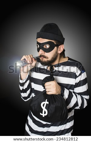 Burglar got caught whlie he is making robbery. - stock photo