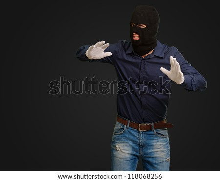 Burglar In Face Mask Isolated On Black Background - stock photo