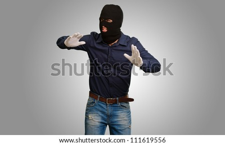 Burglar In Face Mask Isolated On Gray Background - stock photo