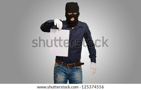 Burglar In Face Mask On Gray Background - stock photo