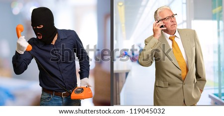 Burglar Man Abusing Businessman On Telephone, Indoors - stock photo