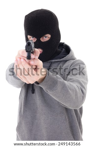 burglar or terrorist in black mask shooting with gun isolated on white background - stock photo