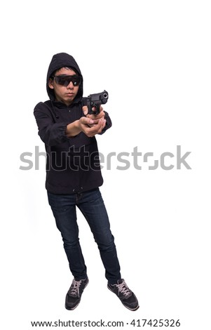burglar or terrorist in black mask shooting with gun isolated on white background.