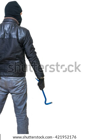 Burglar or thief from behind holds crowbar in hand. Rear view. Isolated on white background. - stock photo