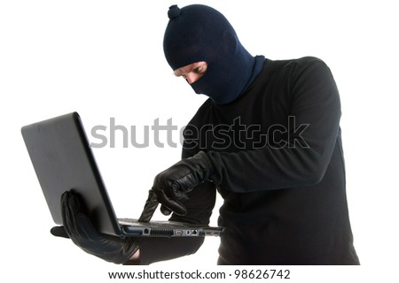 Burglar with computer - isolated on white - stock photo