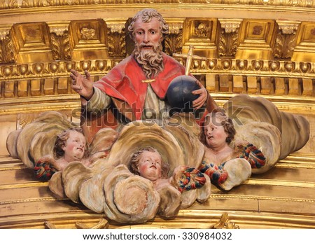 BURGOS, SPAIN - AUGUST 13, 2014: Polychrome sculpture of God and Three Angels in Heaven, in the Cathedral of Burgos, Castille, Spain - stock photo