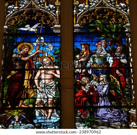 BURGOS, SPAIN - AUGUST 13, 2014: Stained glass window depicting the Baptism of Jesus by Saint John in the cathedral of Burgos, Castille, Spain. - stock photo