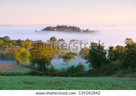 Burgundy landscape in morning mist, France