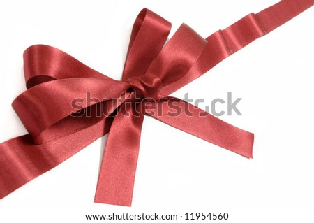 Burgundy magenta red bow gift ribbon diagonal close up