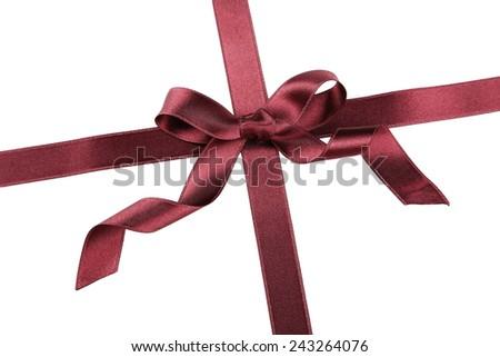 Burgundy ribbon with bow on white background - stock photo