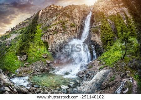 Burhan Bulak Mountain waterfall in Dzungarian Alatau, Kazakhstan, Central Asia - stock photo