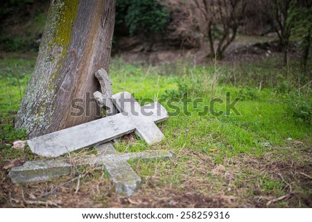 Burial cross in a graveyard  - stock photo
