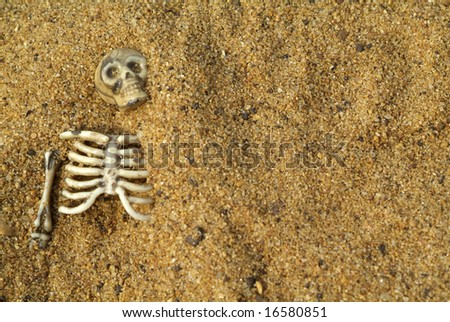 Buried skeleton bones halloween background - stock photo