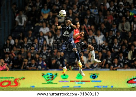 BURIRAM THAILAND-DECEMBER 31:Franck Ohandza Zoa (14)in action during Thai Premier League (TPL) between  Buriram PEA(B) and MuangThong utd (R) at I-mobile Stadium on -DECEMBER 31, 2011 Buriram Thailand - stock photo