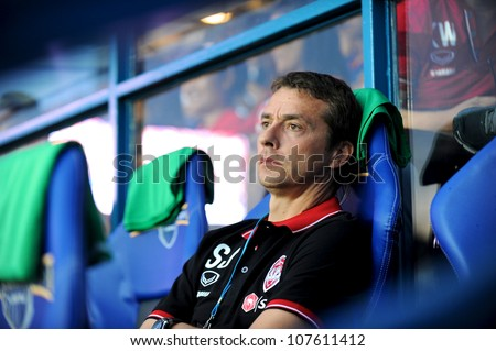BURIRAM,THAILAND-MAY30:Head coach Slavisa Jokanovic of SCG MuangThong Utd.in action during Thai Premier League between Buriram Utd.and SCG Muangthong UTD.at I-mobile Stadium on May30,2012 in Thailand