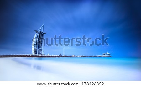 Burj Al Arab hotel on Jumeirah beach in Dubai, modern architecture, luxury beach resort, summer vacation and tourism concept - stock photo