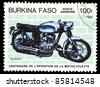BURKINA FASO-CIRCA 1985: A stamp printed in Burkina Faso shows image of a vintage motorcycle, Ducati, circa 1985 - stock photo
