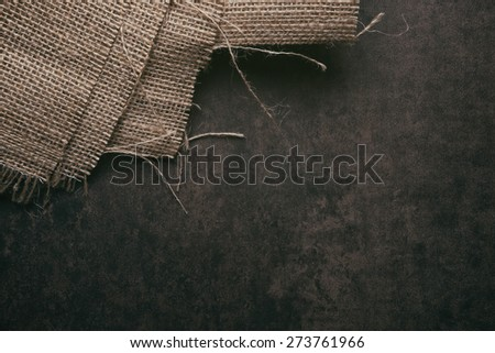 Burlap on a rusitc background - stock photo