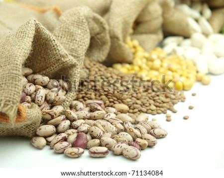 Burlap sacks with  legumes - stock photo
