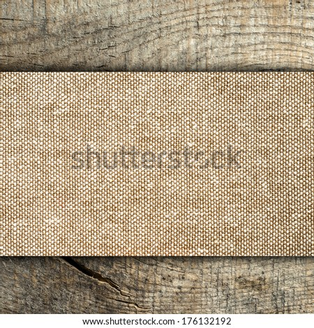 Burlap texture on wooden table background  - stock photo