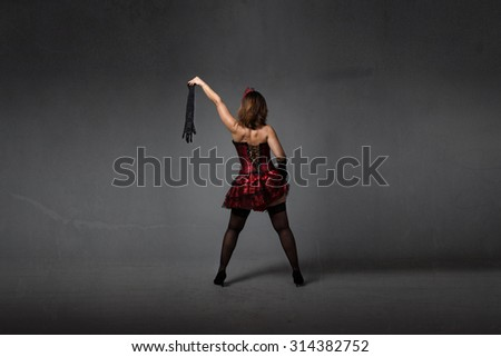 burlesque dancer with socks on hand, textured background - stock photo