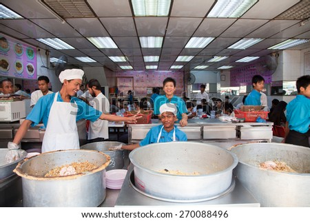 BURMA, RANGOON - FEBRUARY 12, 2011: Local restaurant with serving lunch noodle food. - stock photo
