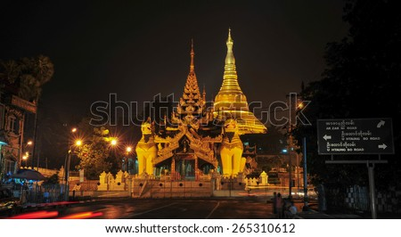 Burmese famous sacred place and tourist attraction landmark - Shwedagon Paya pagoda illuminated in the evening, Yangon, Myanmar (Burma). - stock photo