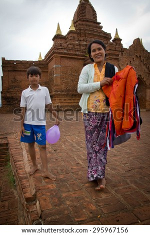 Burmese woman selling clothes in the temple in Bagan, February 14, 2013 - stock photo