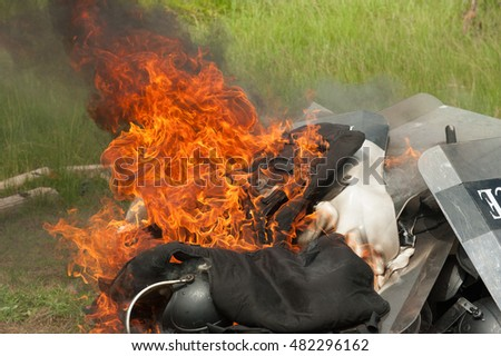 Burn and destroy the equipment of crowd control, riot police.