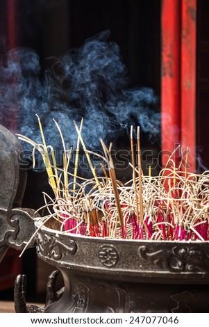 Burn incense - stock photo