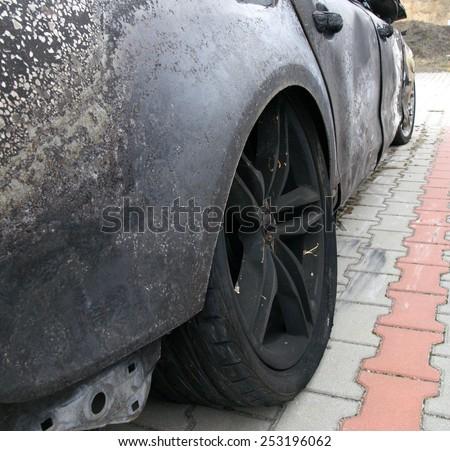 Burn sport car - rear right wheel burn - stock photo