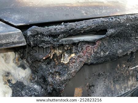 Burn sports car wreck - left rear light  - stock photo