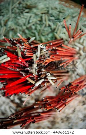 burned Incense sticks in joss-stick pot - stock photo