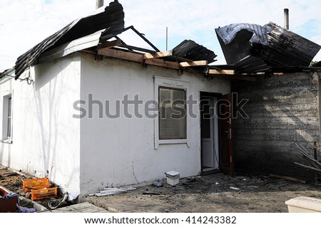 Burned out house after fire