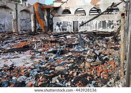 Burned Sweatshop Garment Factory After Fire Disaster - stock photo