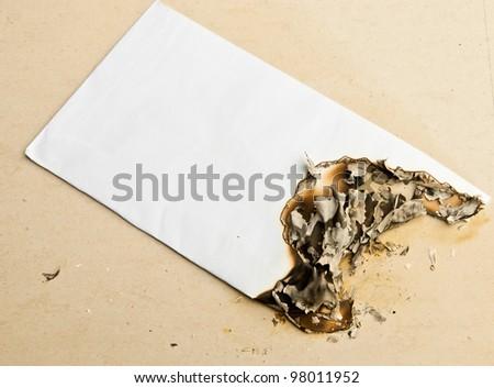 Burned white envelope - stock photo