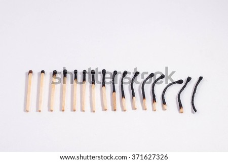 burned wooden matches in order - stock photo