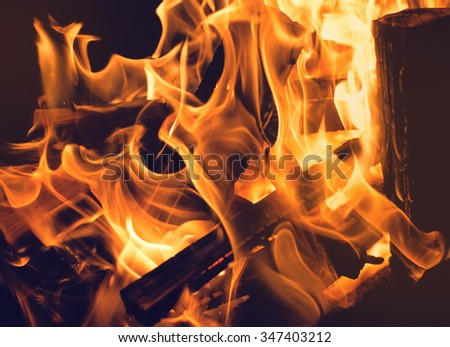 Burning and glowing pieces of wood in Fireplace. - stock photo