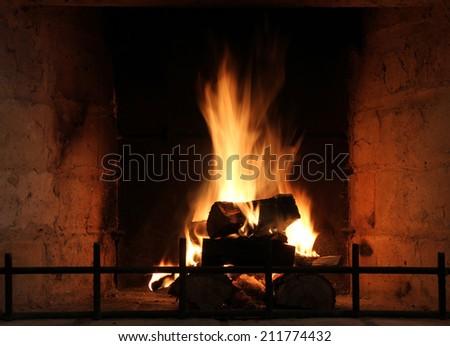 Burning billets in hot stove - stock photo