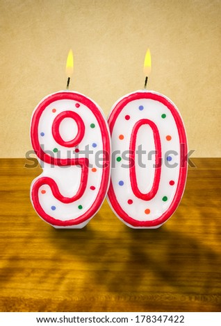 Burning birthday candles number 90 - stock photo